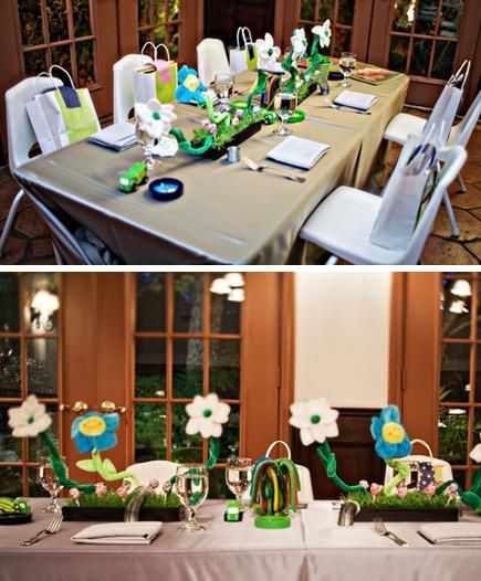 Cute kids table for the wedding with fun flowers in blue, green, white and yellow