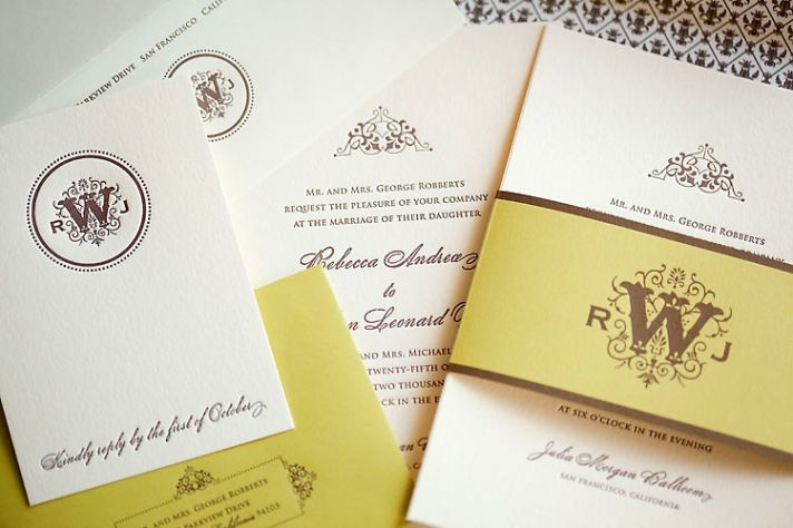 Letterpress wedding invitation with chocolate-colored monogram and chartreuse belly band