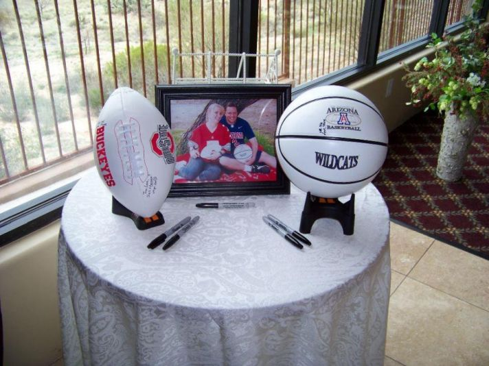 Have guests sign football or basketball at welcome table for a cute wedding keepsake