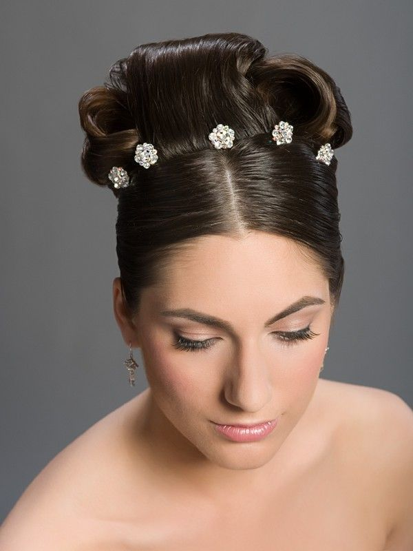 jewels shaped like flowers perfect detail for wedding day hairstyle