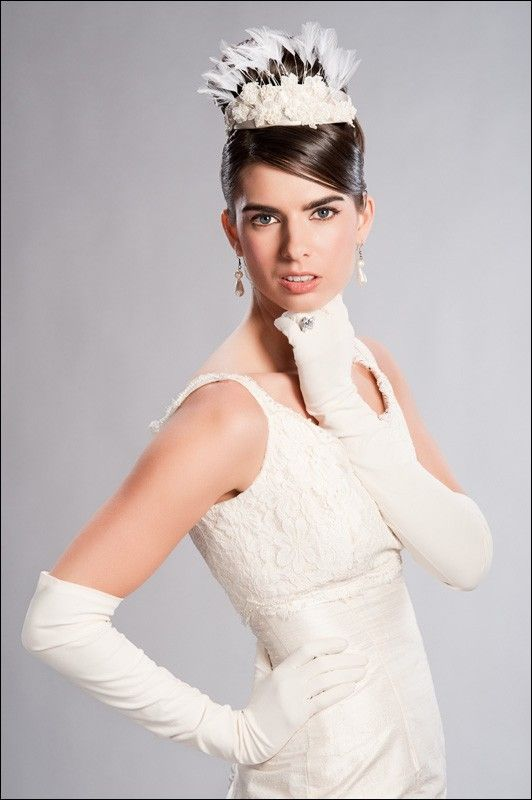 Amy-Jo Tatum white headpiece with flower and feather detail, inspired by Audrey Hepburn