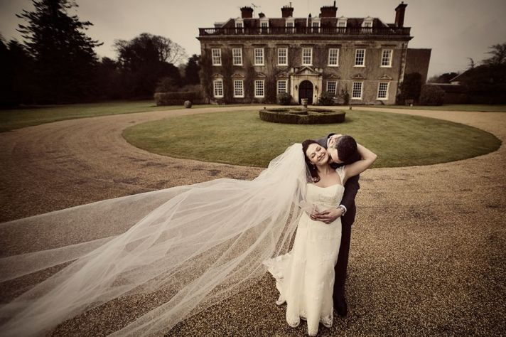 Bride and groom together outside England's Bradley House