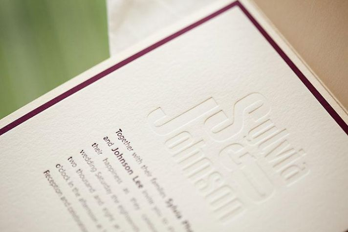 Beatiful white letterpress wedding invitations with wine colored border