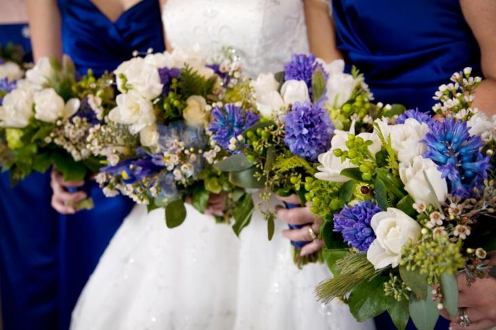 Beautifully coordinated dresses and bouquets