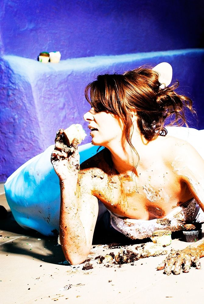 Bride trashes the dress, lays down in mud and dirt, periwinkle blue background