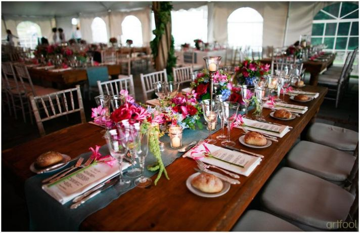 Stunning tablescape (long picnic style) for outdoor wedding reception in white tent