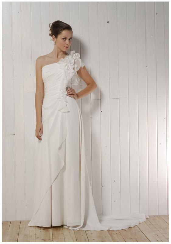 Beautiful white wedding dress, asymmetrical with floral details