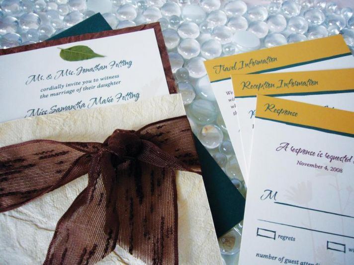 Stunning chocolate brown, gold and white wedding stationery with leaf detail