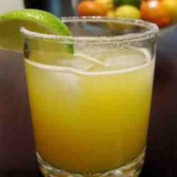 A refreshing lime margarita on the rocks.