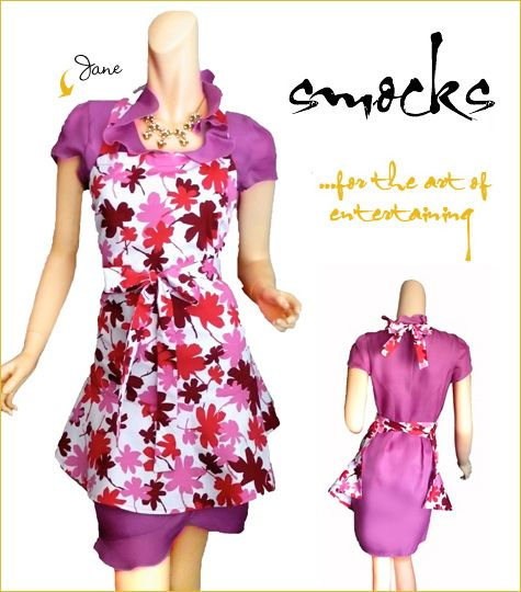 The purple, pink, and lilac flowers decorating this smock style apron are pretty enough to be worn o
