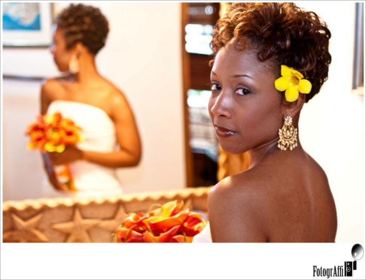 The yellow flower in her hair works perfectly with the bride's skin color and her short, curly brida
