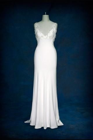 Stunning white bias cut wedding dress with understated feather detail at top