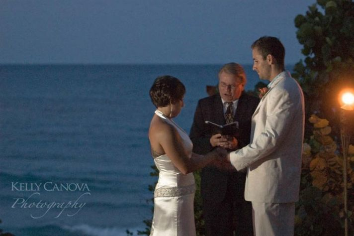 The groom's light colored suit and the bride's sophisticated dress were perfect for this wedding hel