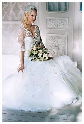 Three quarter sleeve white wedding dress with embroidered tulle skirt