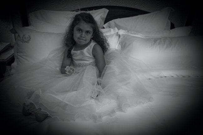 This beautiful young girl looks sweet in her mini wedding dress.