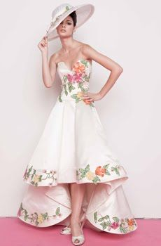 Deep sweetheart neckline retro wedding dress with bold floral border in green, peach and pink