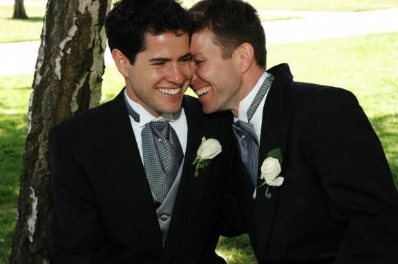 These two grooms look handsome and stylish in their matching morning suits with grey ties. Choosing