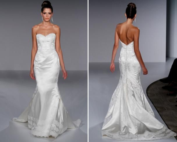 A-line strapless white wedding dress with bands of lace on the hem of the skirt