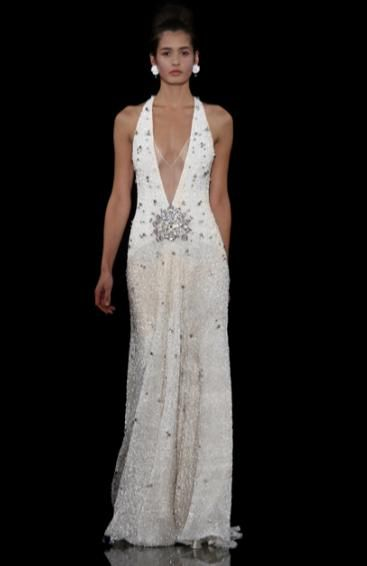 Sheath style beaded wedding dress with plunging neckline and rhinestone brooch