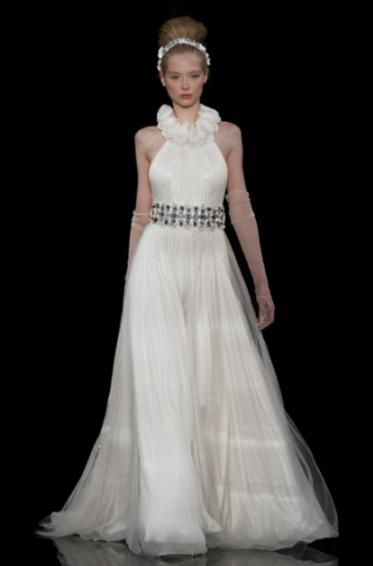 A-line ivory wedding dress with turtle neck collar made from fabric rosettes and jeweled belt at nat