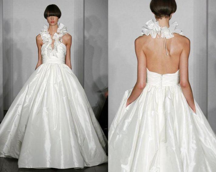 White ballgown wedding dress from Amsale with ruffled halter neckline and pockets