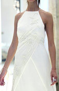 White wedding dress with modest bib-halter and white floral embroidery