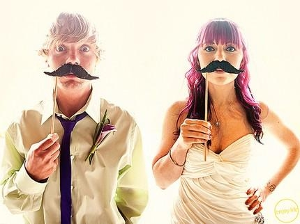 bride-and-groom-get-silly-pose-with-mustache-on-stick