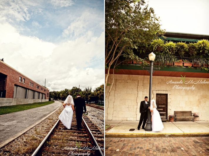 Bride and groom walk together outside down rail road tracks and pose near lightpole