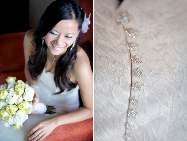 Bride in ivory strapless mermaid lace wedding dress with rhinestone covered buttons, white flower in