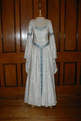 This renaissance style white wedding dress with blue details may help a bride combine a traditional
