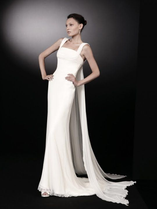 Inspired by architecture, this white square neck wedding dress is simply stunning