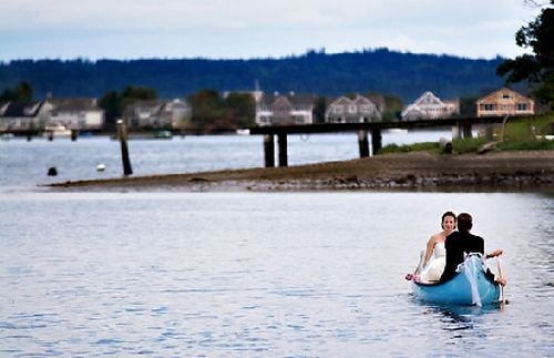 Bride and groom row in canoe to wedding reception after saying I Do!