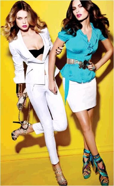 Jet set to your honeymoon in style in this white cotton jacket and skinny pants suit from bebe