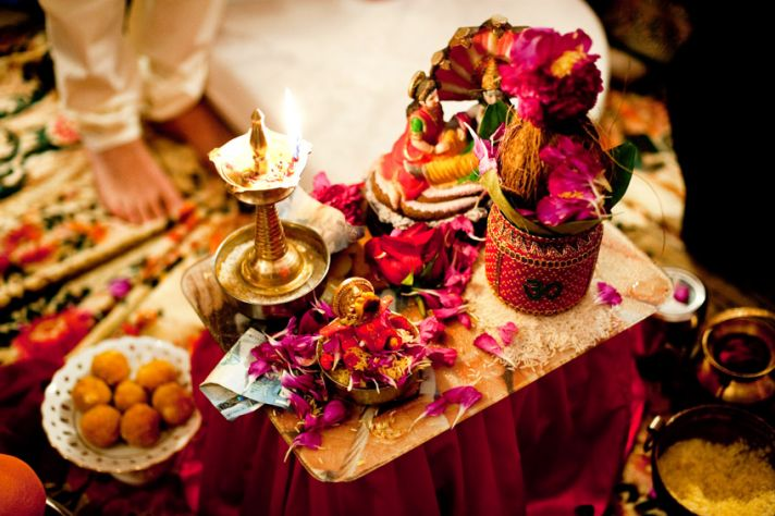 Vibrant and ornate ceremony table during pre-wedding Hindu wedding