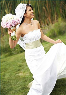 Gorgeous white lace strapless wedding dress with champagne cummerbund sash