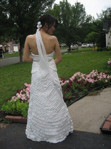 This is the back view of a white wedding dress with pleated detailing made from toilet paper.