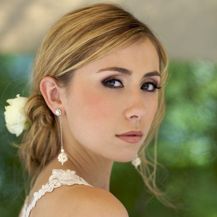 Beautiful drop pearl cluster bridal earrings with loose bridal updo