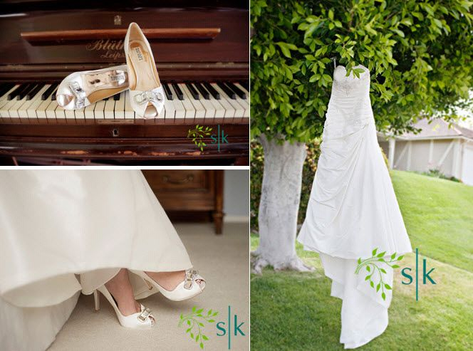 Brides white satin peep toe Badgley Mischka shoes sit on grand piano; white wedding dress hangs outs