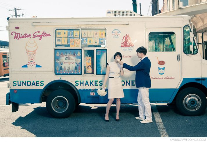 Retro groom offers ice cream cone to vintage bride, pose in front of vintage ice cream truck