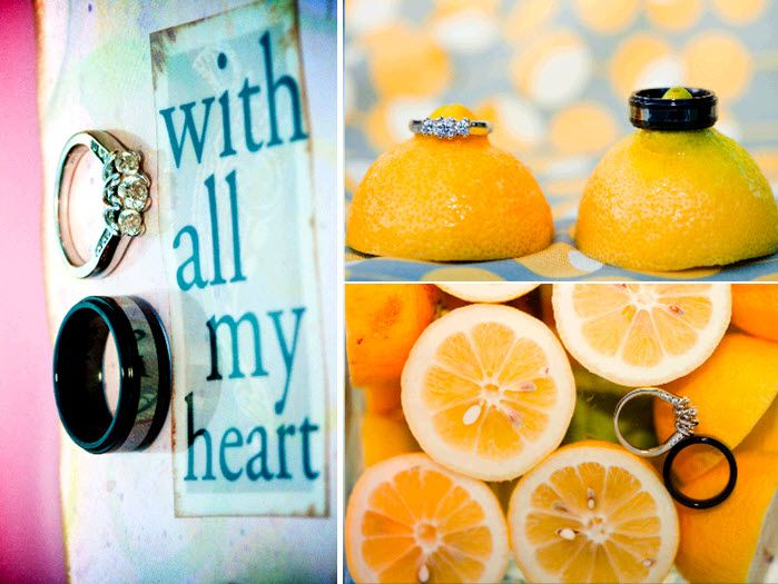 Bride's engagement ring and grooms wedding band sit on bright yellow lemons