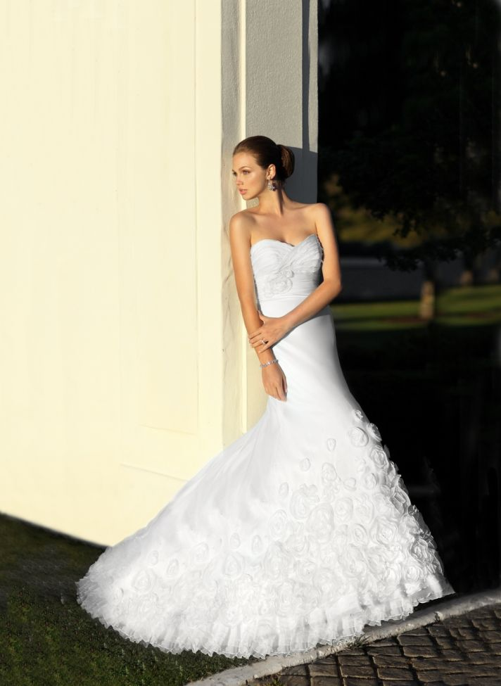 White strapless wedding dress with trumpet skirt covered in floral applique