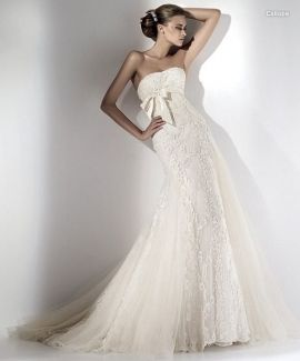 Is this bride in her Ellie Saab strapless white wedding dress doing a sniff check on her underarms?