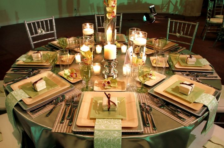 A gorgeous celery green, natural wood, and chocolate brown enchanted garden tablescape for your rece
