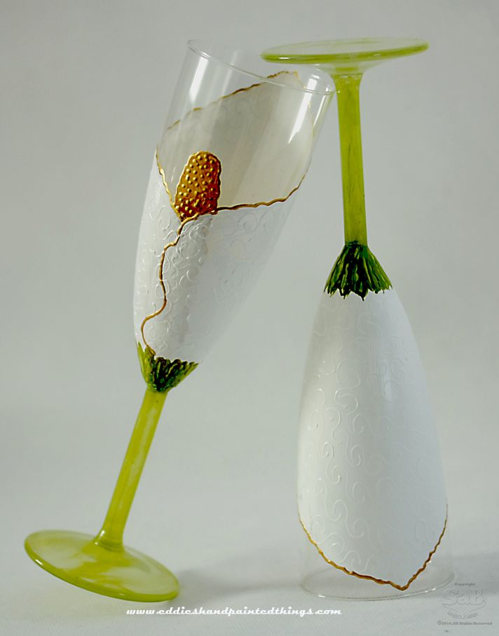 Gorgeous hand painted toasting flutes featuring a white and gold tulip design