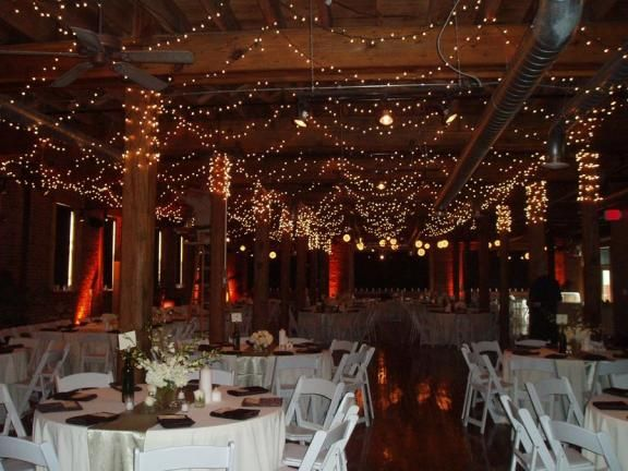 This Christmas wedding is beautifully decorated with tiny christmas lights and white flowers.