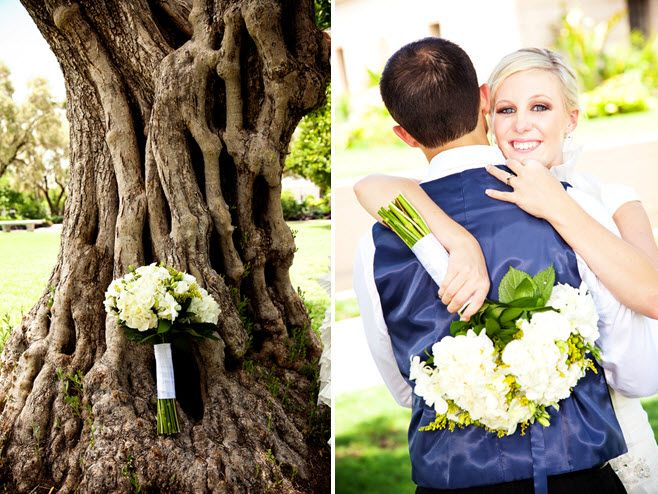 Bride's ivory and green fresh flower bridal bouquet photographed artistically against large tree