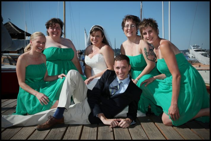 This bridal party is wearing emerald green dresses from Dessy.