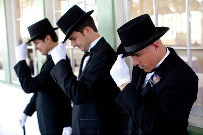 Austin, TX wedding ushers dress like wild west gentleman, complete with black top hats & white glove
