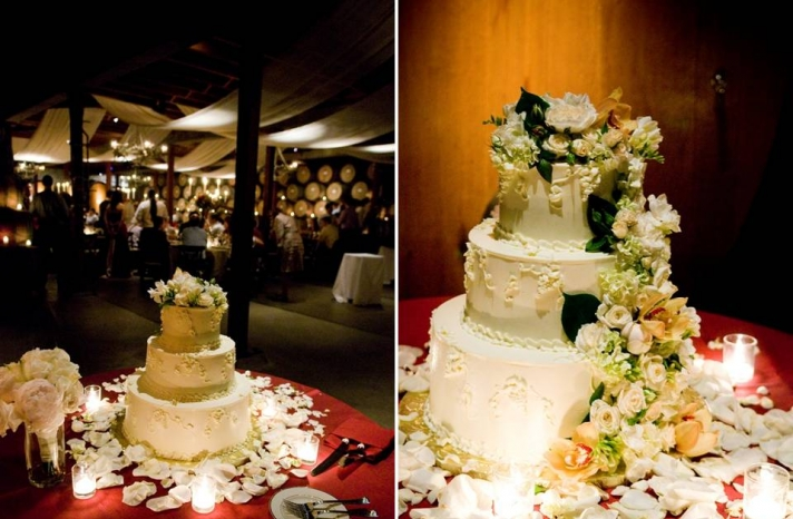 classic-white-three-tier-wedding-cake-red-white-rose-petals-scattered