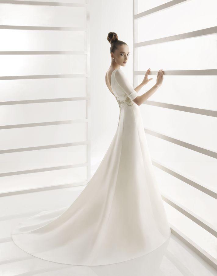 A-line modest wedding dress with three quarter length sleeves